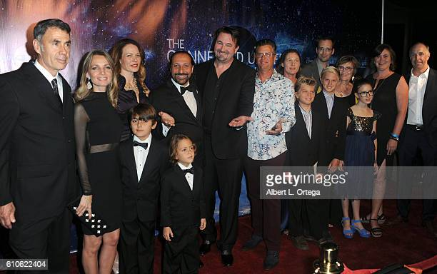 Producer Mark Sims Nassim Haramein director Malcom Carter and Chris Almida executive director of Resonance Science Foundation and family arrive for...
