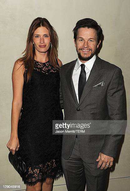 Producer Mark Wahlberg and his wife Rhea Durham arrive at the Giorgio Armani / Vanity Fair private dinner on October 11 2011 in Los Angeles California