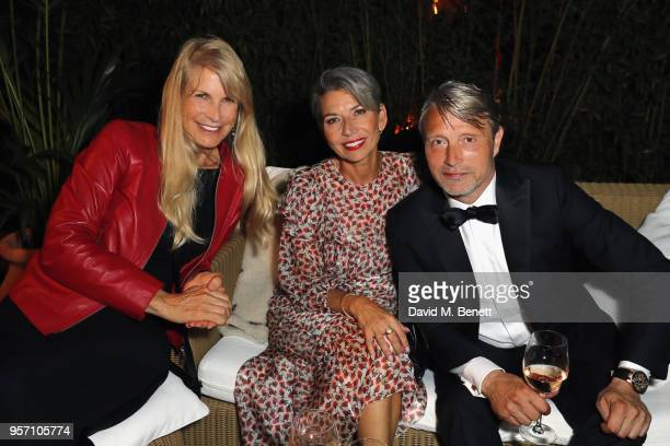 Producer Martha De Laurentiis Hanne Jacobsen and actor Mads Mikkelsen at the Arctic premiere party presented by PerrierJouet at Nikki Beach on May 10...