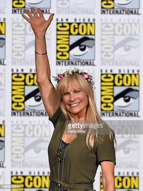 Producer Martha De Laurentiis waves as she arrives at the 'Hannibal' Savor the Hunt panel during ComicCon International 2015 at the San Diego...