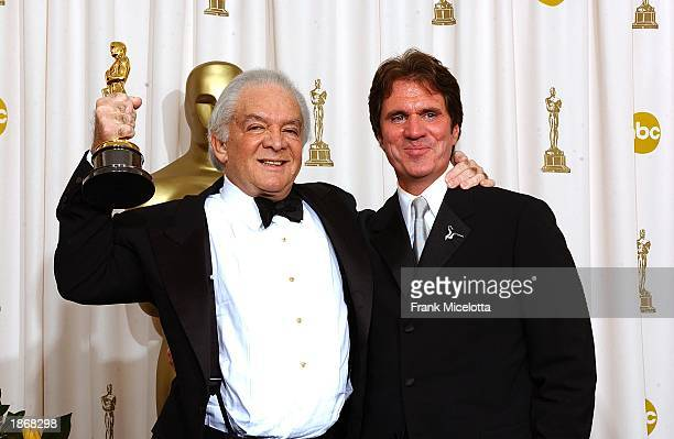 Producer Martin Richards and director Rob Marshall pose after winning Best Motion Picture Of The Year Award for Chicago during the 75th Annual...