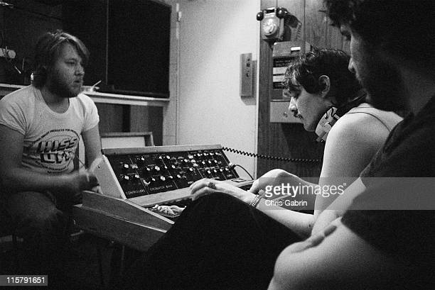 Producer Martin Rushent with keyboard player Dave Greenfield and drummer Jet Black of The Stranglers during recording of their second album 'No More...