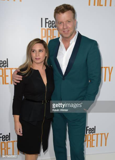 Producer Mary Viola and producer McG attend the premiere of STX Films' 'I Feel Pretty' at Westwood Village Theatre on April 17 2018 in Westwood...