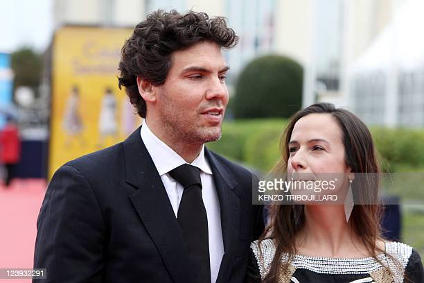 US producer Matthew Gordon poses with French producer Marianne Michallet on the red carpet before the screening of The dynamiter as part of the 37th...