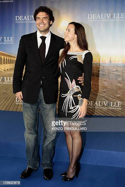 US producer Matthew Gordon poses with French producer Marianne Michallet during the photocall of the movie The Dynamiter presented in competition at...