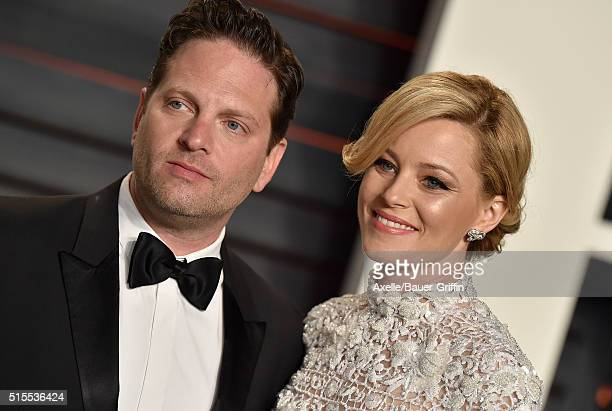 Producer Max Handelman and actress Elizabeth Banks arrive at the 2016 Vanity Fair Oscar Party Hosted By Graydon Carter at Wallis Annenberg Center for...