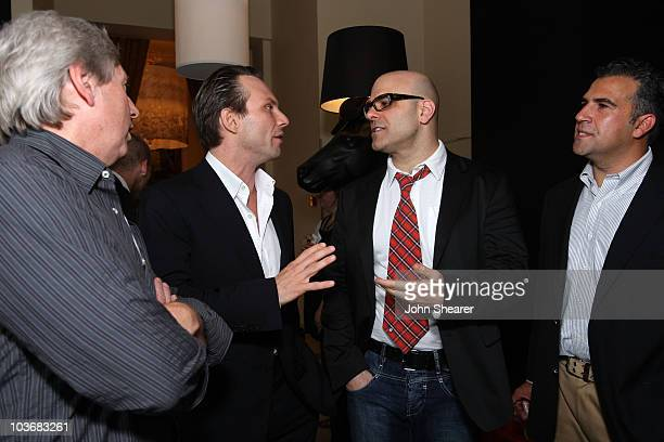 Producer Max Howard actor Christian Slater director Tony Leondis and Exodus Film Group CEO John Eraklis attend the Igor reception photocall in the HP...