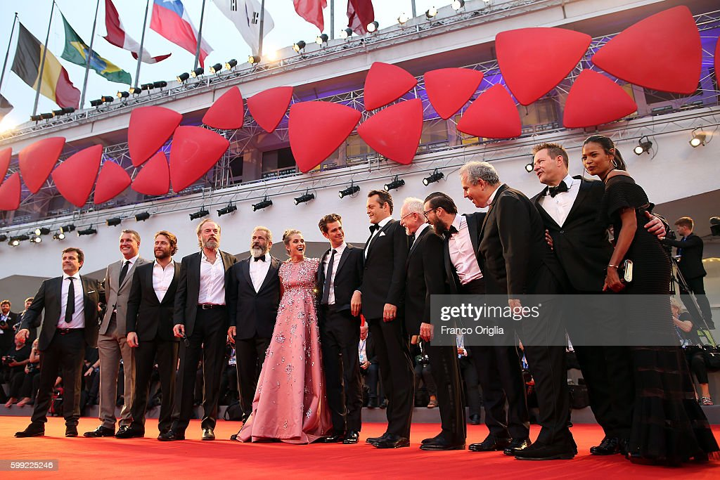 Producer Michael Bassick, actors Luke Bracey, Hugo Weaving, director Mel Gibson, actress Teresa Palmer, actor Andrew Garfield, actor Vince Vaughn, screenwriter Robert Schenkkan and guest attend the premiere of 'Hacksaw Ridge' during the 73rd Venice Film Festival at Sala Grande on September 4, 2016 in Venice, Italy.
