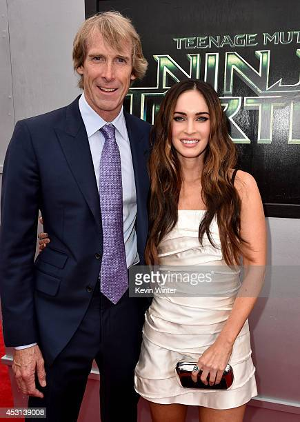 Producer Michael Bay and actress Megan Fox attend the premiere of Paramount Pictures' Teenage Mutant Ninja Turtles at Regency Village Theater on...