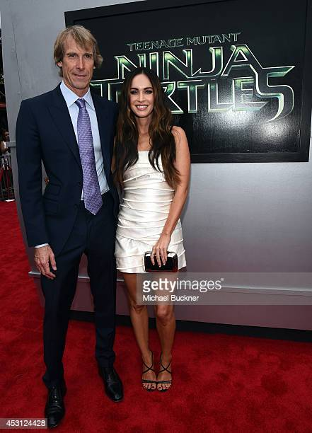 Producer Michael Bay and actress Megan Fox attends the premiere of Paramount Pictures' Teenage Mutant Ninja Turtles at Regency Village Theatre on...