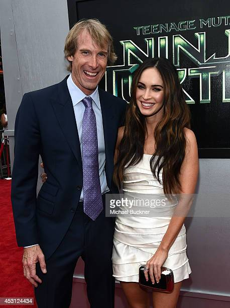 Producer Michael Bay and actress Megan Fox attends the premiere of Paramount Pictures' 'Teenage Mutant Ninja Turtles' at Regency Village Theatre on...