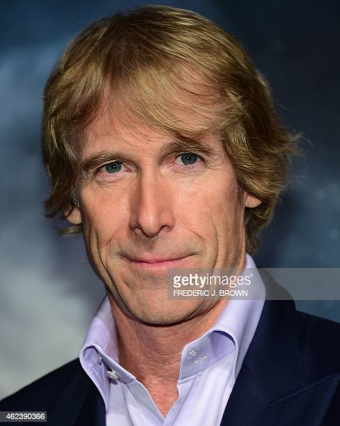 Producer Michael Bay poses on arrival for the Los Angeles Premiere of Project Almanac on January 27 2015 in Hollywood California The film opens...