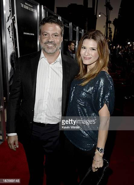 Producer Michael De Luca and Angelique Madrid arrive at the premiere of Columbia Pictures' 'Captain Phillips' at the Academy of Motion Picture Arts...