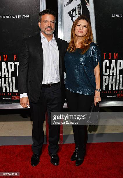Producer Michael De Luca and his wife Angelique Madrid arrive at the Los Angeles premiere of 'Captain Phillips' at the Academy of Motion Picture Arts...