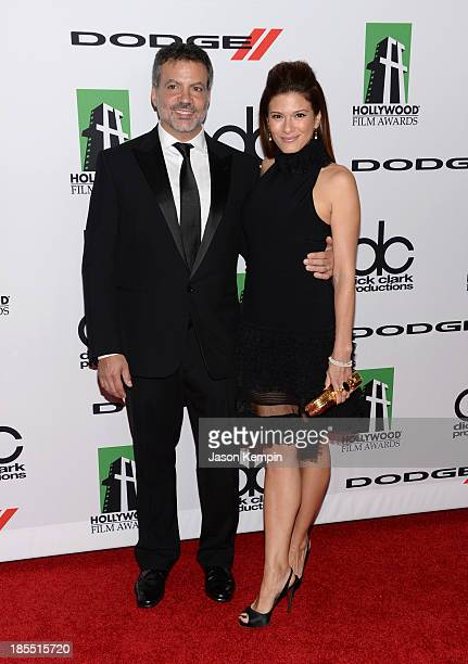 Producer Michael DeLuca and wife Angelique Madrid arrive at the 17th annual Hollywood Film Awards at The Beverly Hilton Hotel on October 21 2013 in...