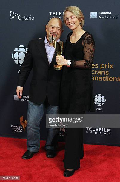 Producer Michael Fukushima and Lise Fearnley pose in the press room at the 2015 Canadian Screen Awards at the Four Seasons Centre for the Performing...