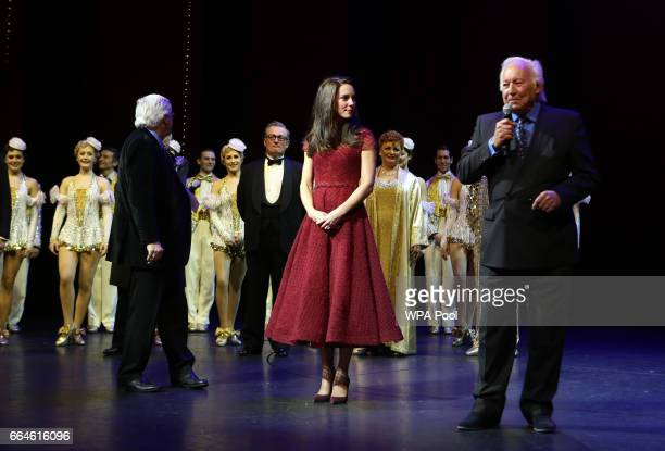 Producer Michael Grade Catherine Duchess of Cambridge and producer Michael Linnet take part in a presentation during the Opening Night Royal Gala...