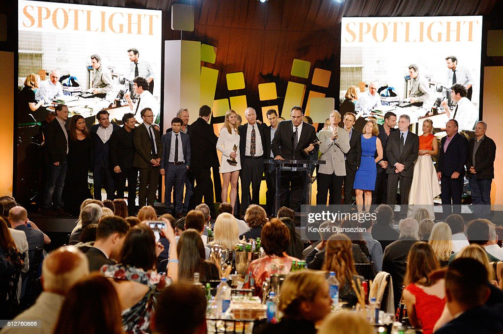 Producer Michael Sugar (at podium) accepts the Best Feature award for 'Spotlight' onstage with members of the film's cast and crew, as well as some of the real people depicted in the film, during the 2016 Film Independent Spirit Awards on February 27, 2016 in Santa Monica, California.