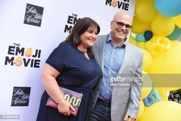Producer Michelle Kouyate and Director Tony Leondis attend the Saks Fifth Avenue window unveiling with the cast of 'The Emoji Movie' at Saks Fifth...