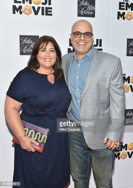Producer Michelle Kouyate and Director Tony Leondis attend the Saks Fifth Avenue window unveiling with the cast of The Emoji Movie at Saks Fifth...