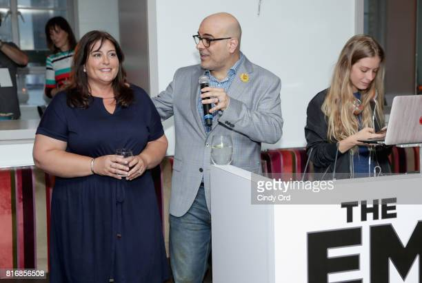 Producer Michelle Kouyate and director Tony Leondis attend the Saks Fifth Avenue and Sony Picture Animation's celebration of The Emoji Movie at Saks...