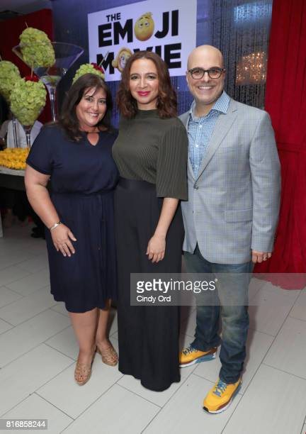 Producer Michelle Kouyate Maya Rudolph and director Tony Leondis attend the Saks Fifth Avenue and Sony Picture Animation's celebration of The Emoji...