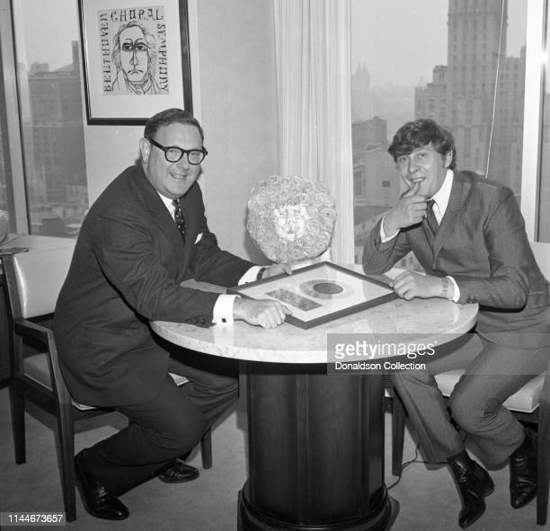 Producer Mickie Most receives a gold record award commemorate a milestone in sales for 'Rocky Mountain Moon' with Bing Satchmo aka Bing Crosby and...