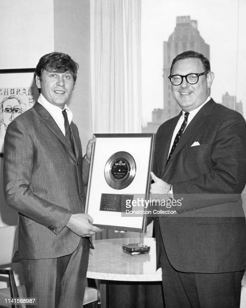 Producer Mickie Most receives a plaque to commemorate a milestone in sales for Rocky Mountain Moon with Bing Satchmo aka Bing Crosby and Louis...