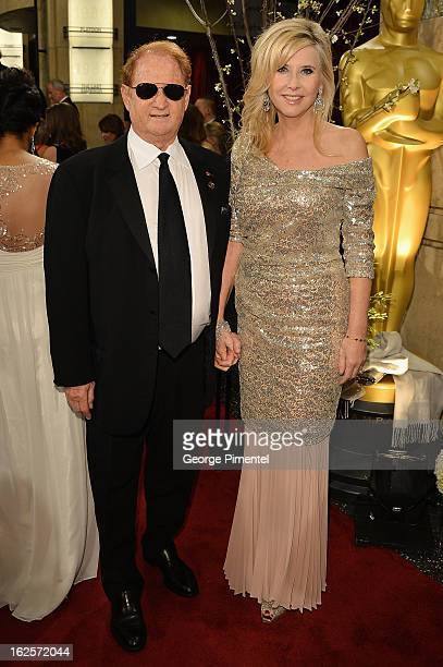 Producer Mike Medavoy and wife Irena Medavoy arrive at the Oscars at Hollywood Highland Center on February 24 2013 in Hollywood California