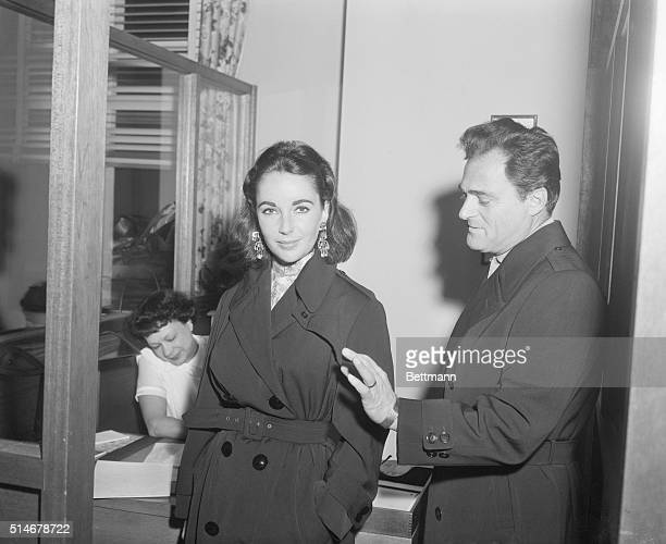 Producer Mike Todd accompanies his wife Elizabeth Taylor into the Cedars of Lebanon Hospital on December 18 1957 She will undergo an appendectomy here