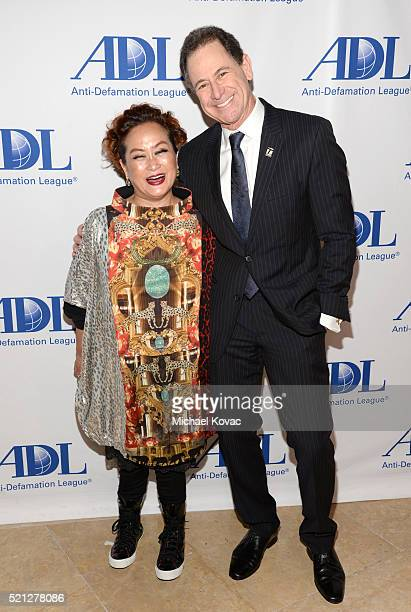 Producer Miky Lee and honoree Ken Solomon attend the ADL Entertainment Industry Dinner at The Beverly Hilton Hotel on April 14 2016 in Beverly Hills...