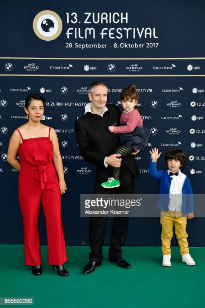 Producer Mirjam Von Arx and director Thomas Haemmerli with kids attend the 'Gentrifizierung' photocall during the 13th Zurich Film Festival on...