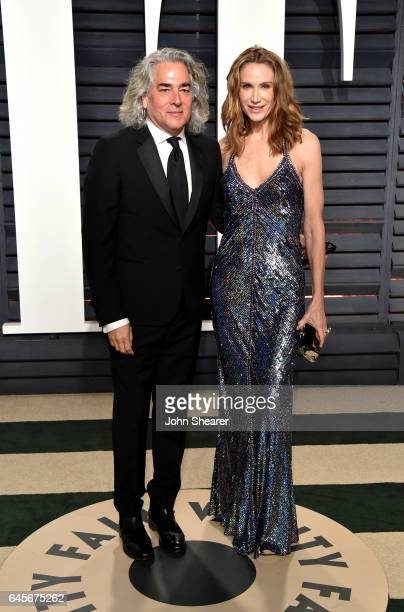 Producer Mitch Glazer and model Kelly Lynch attends the 2017 Vanity Fair Oscar Party hosted by Graydon Carter at Wallis Annenberg Center for the...