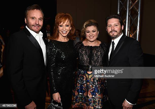 TV Producer Narvel Blackstock singers Reba McEntire Kelly Clarkson and Brandon Blackstock attend Muhammad Ali's Celebrity Fight Night XXI at the JW...