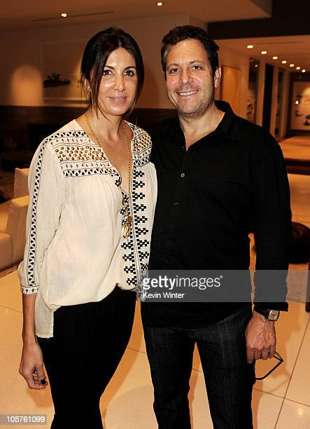 Producer Nathalie Marciano and writer/producer/director Darren Star pose at a reception for IFC Films' Inhale at a private residence on October 19...