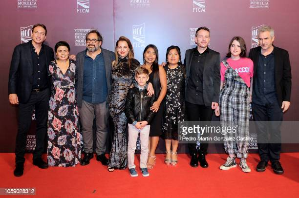 Producer Nicolas Celias, Eugenio Caballero, Yalitza Aparicio, Marina de Tavira, Nancy Garcia, Fernando Grediaga and Alfonso Cuaron pose during the...