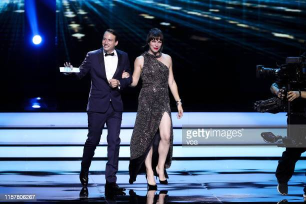 Producer Nicolas Celis and actress Milla Jovovich attend the Closing and Golden Goblet Awards Ceremony of the 22nd Shanghai International Film...