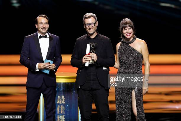 Producer Nicolas Celis cinematographer Jake Pollock and actress Milla Jovovich attend the Closing and Golden Goblet Awards Ceremony of the 22nd...