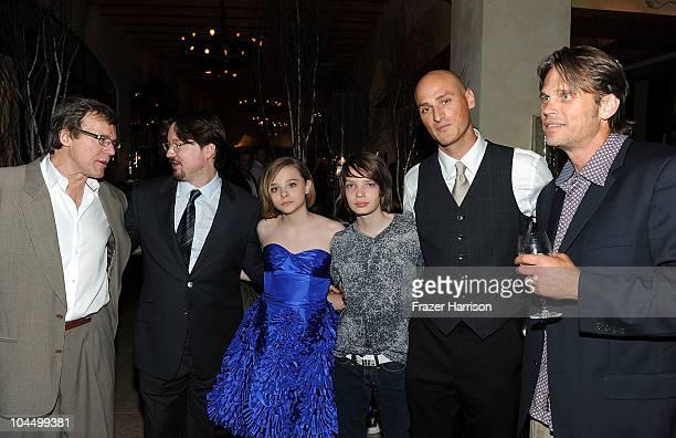 Producer Nigel Sinclair director Matt Reeves actors Chloe Moretz Kodi SmitMcPhee Dylan Kenin and Chris Browning attend the premiere of Overture's Let...