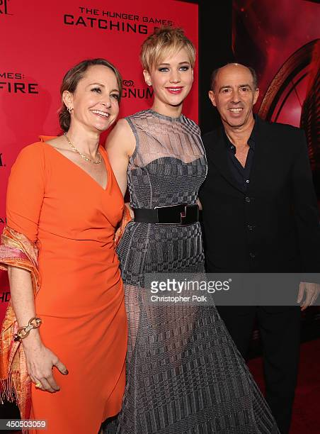 Producer Nina Jacobson actress Jennifer Lawrence and producer Jon Kilik attend premiere of Lionsgate's The Hunger Games Catching Fire Red Carpet at...