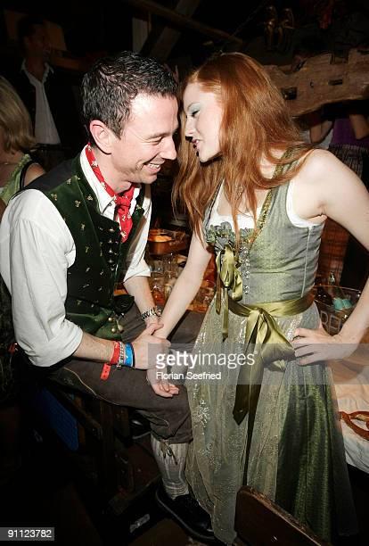 Producer Oliver Berben and model Barbara Meier attend the Oktoberfest 2009 at Kaefer Schaenke at the Theresienwiese on September 24 2009 in Munich...