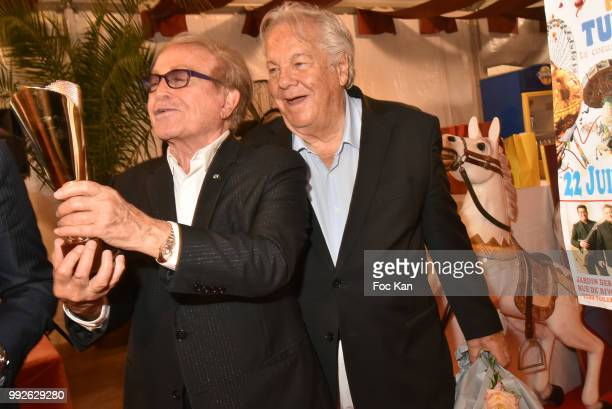 Producer Orlando and Massimo Gargia Attend 'La Femme Dans Le Siecle' Dinner on July 5 2018 in Paris France