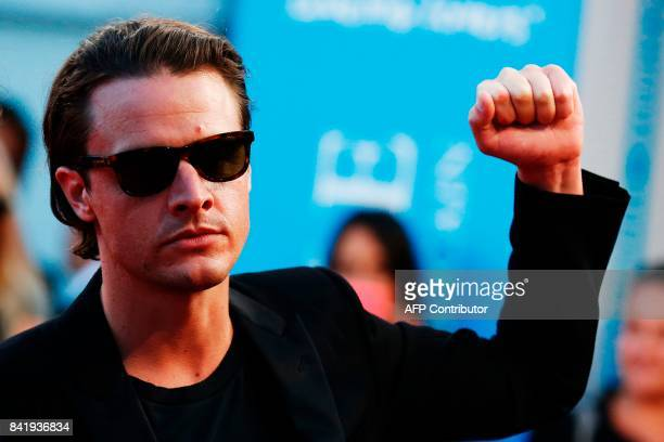 US producer Oscar Boyson gestures as he arrives for the screening of the film 'Good Time' during the 43rd Deauville US Film Festival in the...