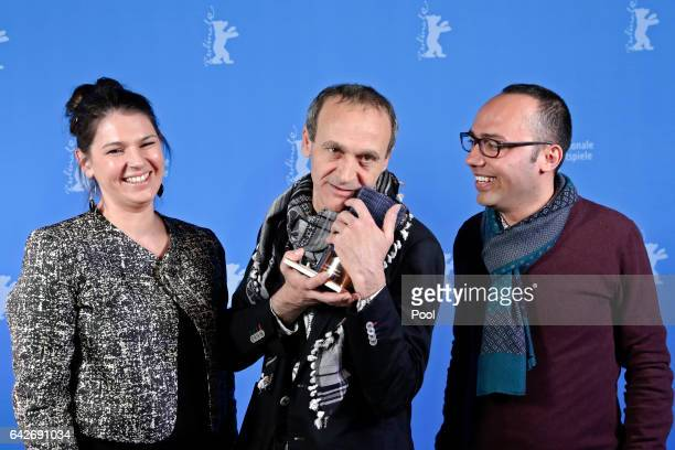 Producer Palmyre Badinier poses with Director Raed Andoni winner of Glashuette Original Documentary Award and assistant director Wadee Hanani...