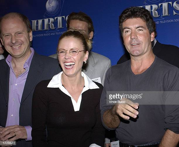 Producer Paul Smith The Bachelorette star Trista Rehn and American Idol television show host Simon Cowell attend the Hollywood Radio and Television...