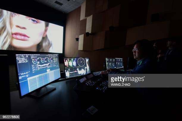 A producer performs colour correction at a film postproduction studio at Wanda Film industrial park in Qingdao China's Shandong province on April 28...