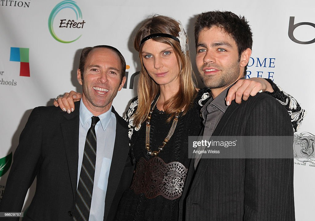 Producer Peter Glatzer, model Angela Lindvall and actor Adrian Grenier attend the 'Global Home Tree' Earth Day VIP reception hosted by James Cameron at the JW Marriott Los Angeles at L.A. LIVE on April 22, 2010 in Los Angeles, California.