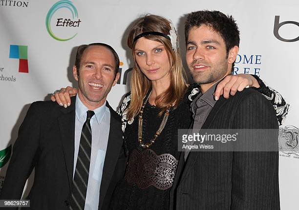 Producer Peter Glatzer model Angela Lindvall and actor Adrian Grenier attend the 'Global Home Tree' Earth Day VIP reception hosted by James Cameron...