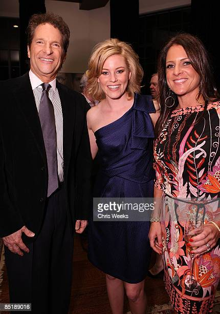 Producer Peter Guber actress Elizabeth Banks and producer Kathy Schulman attend the Women In Film Oscar Nominee Reception hosted by PerrierJouet held...