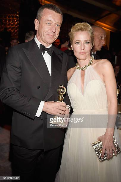 Producer Peter Morgan and actress Gillian Anderson attend The Weinstein Company and Netflix Golden Globe Party presented with FIJI Water Grey Goose...